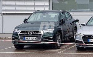 El nuevo Audi Q5 e-tron cazado al desnudo durante una recarga